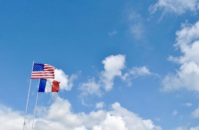 American and French flags. Image Credit: Flickr/Angela Guedes Dias