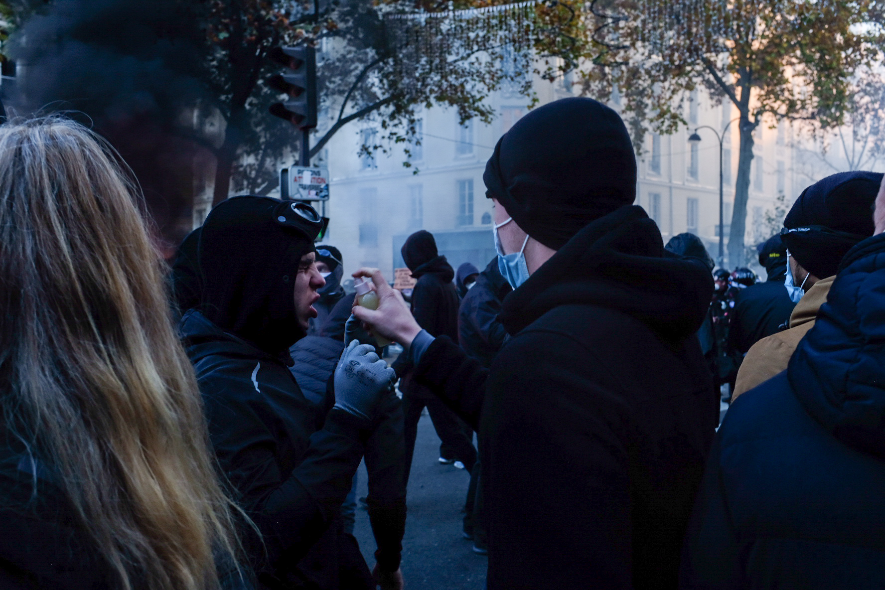 Demonstrator suffers from tear gas at the November 28 protest. Image Credit: Amy Thorpe