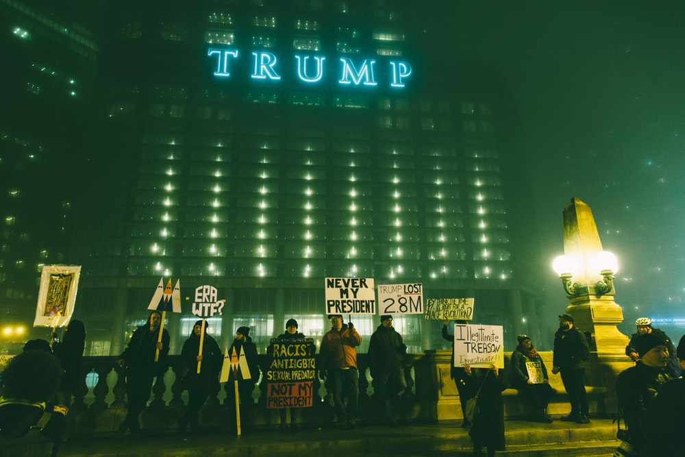 Protesters in front of a Trump building