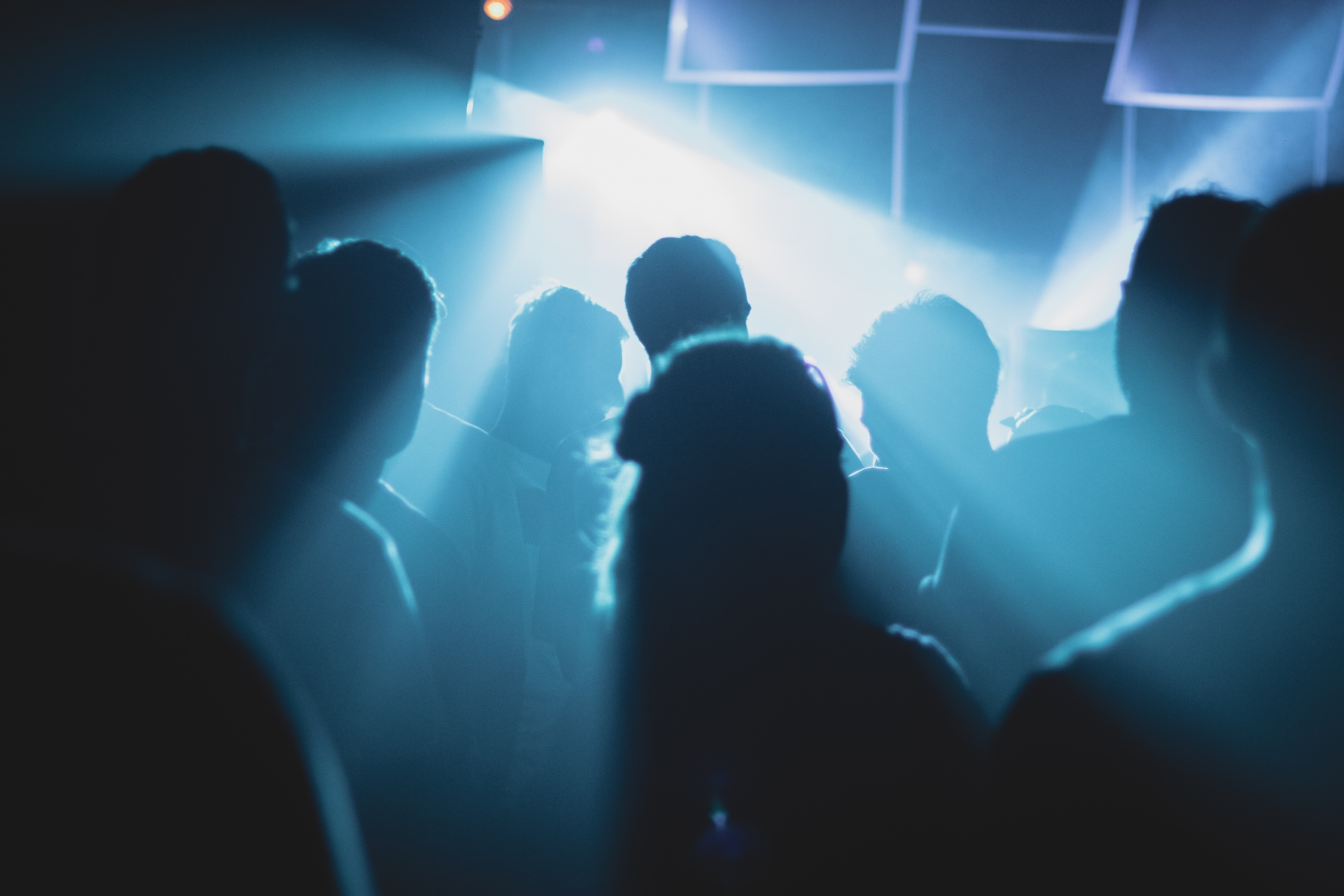 Girl crowded at a party. Image credit: Baptiste MG on Unsplash.