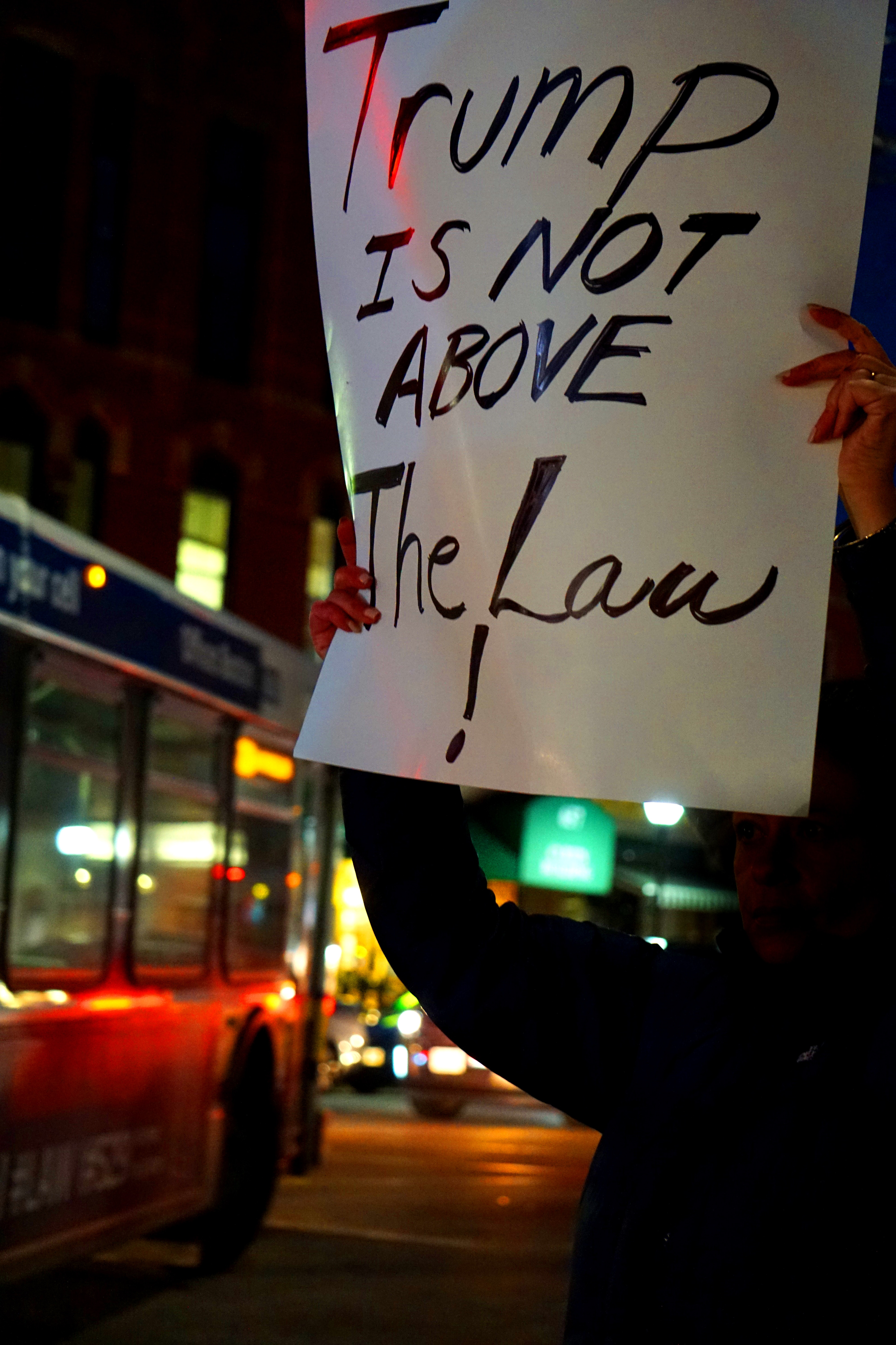 """Trump is not above The Law"" sign / Photo credit: LS d'Avalonia on Unplash"