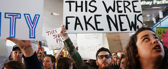 """I wish this was Fake News"" sign at the LAX protest against Trump's muslim ban. / Photo credit: Kayla Velasquez on Unsplash"
