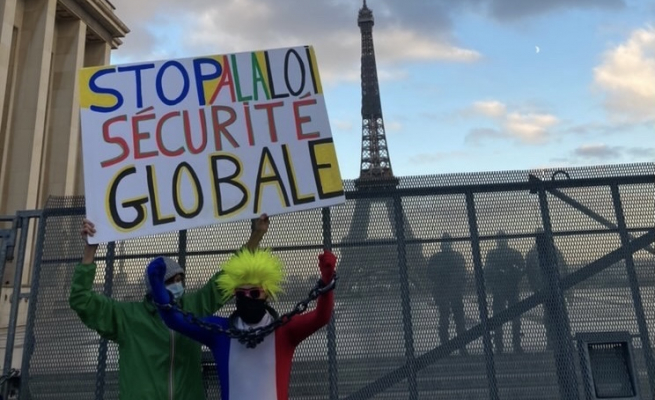 """Stop the Global Security Law"" banner at the Trocadero protest. Image Credit: Meredith Miller."
