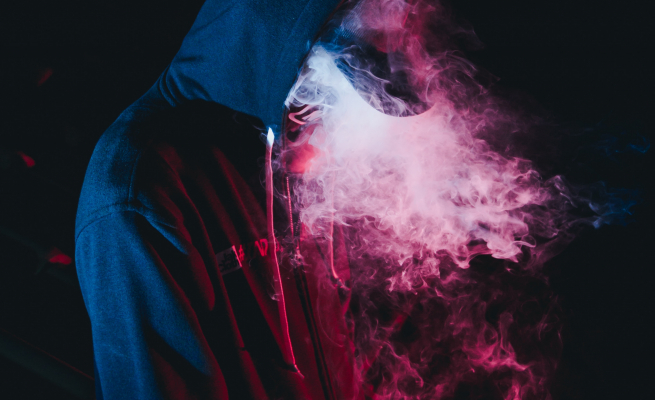 Man in hoody vaping -- Photo by Wild Vibes on Unsplash