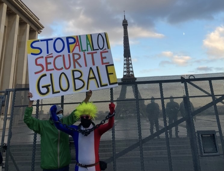 """""""Stop the Global Security Law"""" banner at the Trocadero protest. Image Credit: Meredith Miller."""