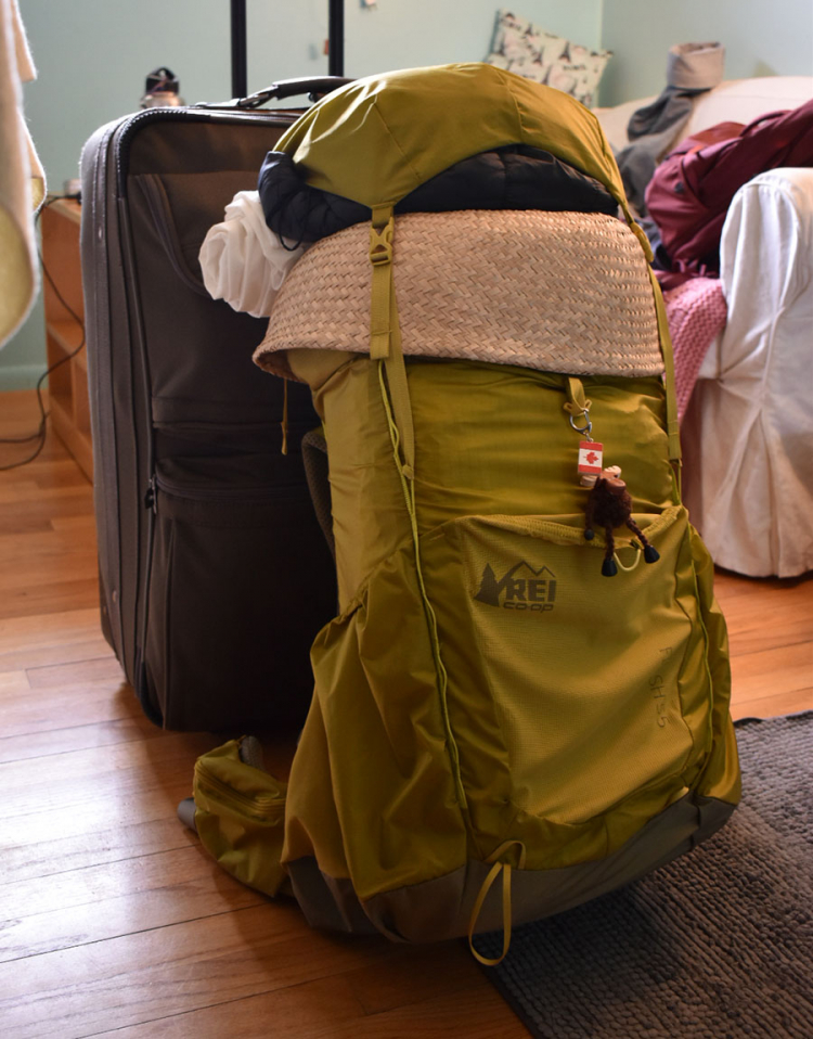 A backpack meant for hiking is loaded to the brim