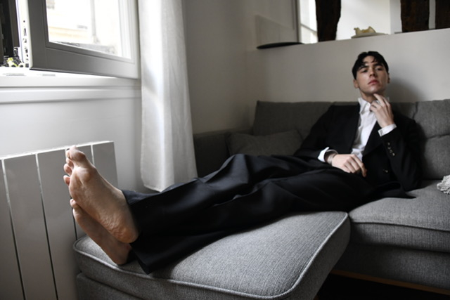 Ryan lounging on his couch in Paris, France. Image credit: David Atticus.