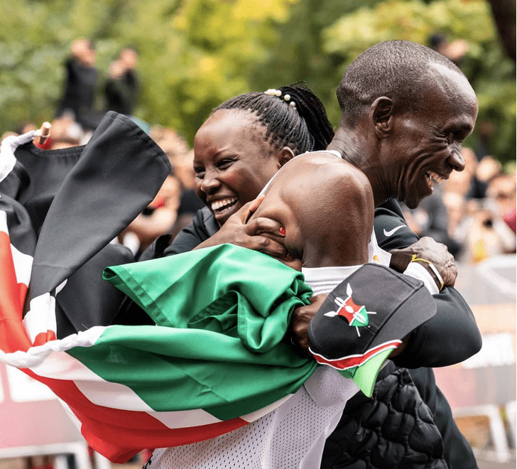 Eliud Kipchoge gets his first hug from Wife,Grace after the finish line/Image Credit: Geoffrey Mbuthia Classic 105