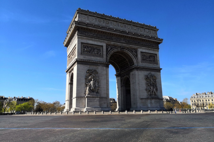 The Arc de Triomphe in Paris, usually a bustling roundabout, stands empty of cars
