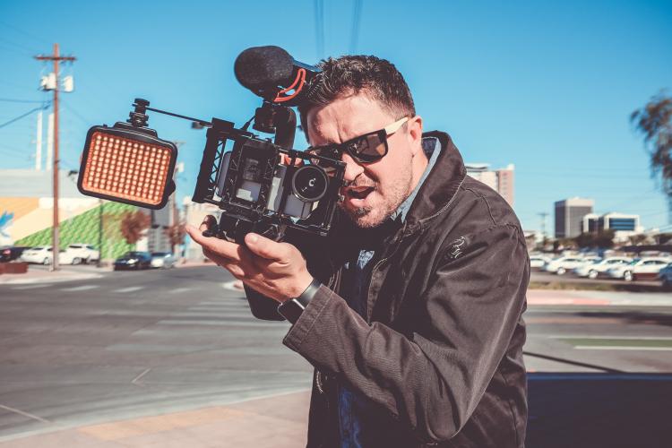 Man filming, Image Credit: NeONBRAND on Unsplash
